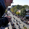 Salem:  Charlie Fox of Belmont watches the motorcycle parade from the top of a Derby St. parking garage.   photo by Mark Teiwes / Salem News