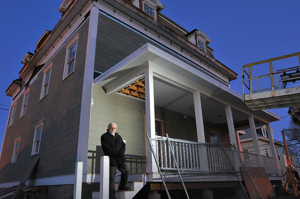 Peabody: Don Preston, Habitat Humanity-North Shore president stands outside a 129-year-old rehabbed property at on Park Street. photo by Mark Teiwes / Salem News