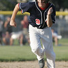 Lynn: Peabody West player Nick Palmer steals third base in the team's win over Salem American in a District 16 little league game.  photo by Mark Teiwes / Salem News