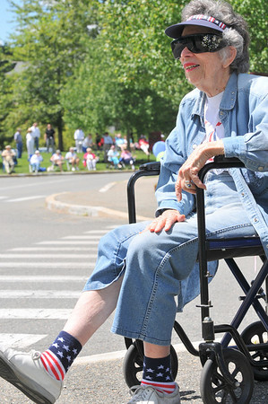 Peabody: Shirley Frisch, a Brooksby Village resident, is dressed from head to toe with red white and blue for the parade.  She says that freedom is something we have to celebrate. photo by Mark Teiwes / Salem News
