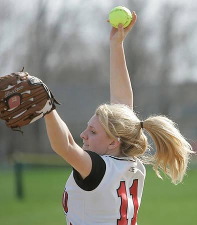 Marblehead:  Marblehead pitcher Sarah Hastings winds up for a pitch.  She designed a bracelet that the team is wearing and is selling all season, with proceeds going to Dana Farber.  She allowed only two hits in the team's 5-1 win over Winthrop.  photo by Mark Teiwes / Salem News