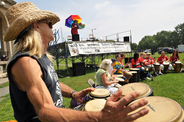 "Salem: Phil ""Two Toes"" Johnson sends out a beat with the AD3 drum circle kicking off beginning of the Salem Culture Fest. photo by Mark Teiwes / Salem News"