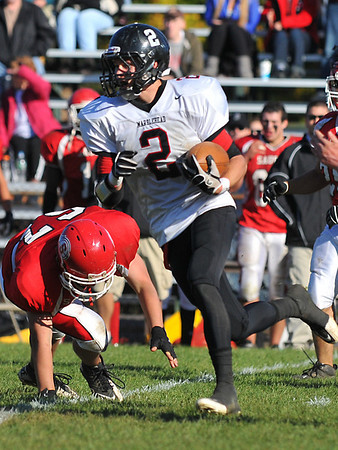 Saugus:  Marblehead's Ryan Stanojev leaves a Saugus defenseman on the ground after cutting across the field.  photo by Mark Teiwes / Salem News