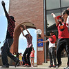 "Peabody: Andrew Sentongo, left, Jared Smith, Tighe Taylor, Nimnajee Jahzeebee, and Liza Pacheco dance with the Peabody dance group ""N3w Lyf3 Kru"" at the Peabody Institute Library's youth event last Saturday. Katie Ridruguez and Karina Usmanova (not pictured) also danced with the group. photo by Mark Teiwes / Salem News"