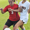 Beverly:  Salem's Brenna Burke, left, fights for the ball with Beverly's Katie Gonzalez.   photo by Mark Teiwes  / Salem News