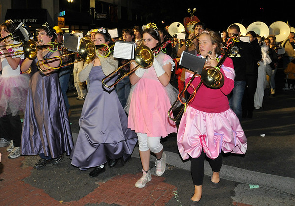 Salem:  Chapin Dwyer, right, was part of line of trombone princesses that lead the Beverly High School band in the Haunted Happenings Grand Parade. photo by Mark Teiwes / Salem News