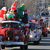 Beverly: The 63rd Beverly Holiday Parade began on Elliot St. with a long line of fire trucks and police cars with sirens blaring. photo by Mark Teiwes / Salem News