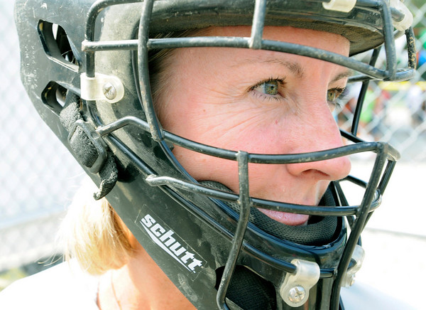 Beverly: Gwen Purtell plays catcher guarding the plate for the Cove Elementary School  at the Momball tournament.  photo by Mark Teiwes / Salem News