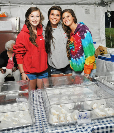 Ipswich: Anna Votze, left, and Emily Votze, of Boxford, along with Sophi Gibbings of Santa Barbara, CA served up pastries during the Greek festival & clambake. photo by Mark Teiwes / Salem News