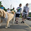 Salem:  Ben Noyes, left, walks his dog aside his brother Zach and Sister Katie. North Shore Cancer Walk.  photo by Mark Teiwes / Salem News