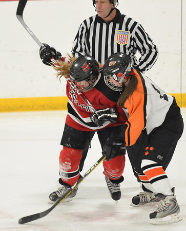 Stoneham: Marblehead #13 Ally Healy, left, battles for a faceoff with Beverly's Livvy Konaxis.  photo by Mark Teiwes  / Salem News