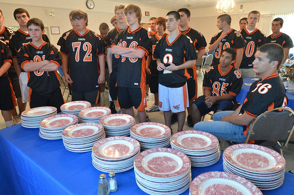 Ipswich: The Ipswich High School football team receives instructions for volunteering.  Ipswich churches and community groups take turns cooking and providing a free meal at the Masonic Lodge. photo by Mark Teiwes /  Salem News