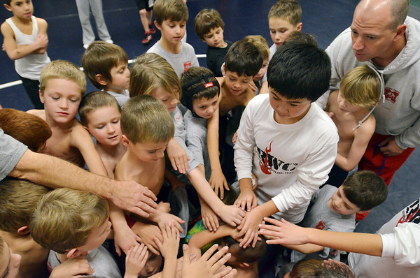 Danvers:  Participants gather together at the end of a practice session.    photo by Mark Teiwes / Salem News