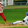 Peabody:  After stealing second base on the previous play, Higgins Middle School player, Kevin Lebell, right, slides safe steeling third base.  photo by Mark Teiwes / Salem News