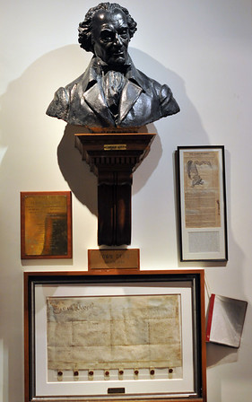 Marblehead:  The collection includes the town dead dated July 14, 1684, and a bust labeled with Elbridge Gerry Art at the Abbot Hall selectman's meeting room.   photo by Mark Teiwes / Salem News