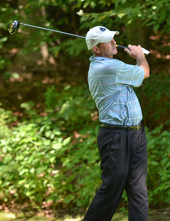 Boxford: Christopher Young of Newbury watches his ball after teeing off on the 18th hole for the North Shore Amateur golf tournament at the Far Corner golf course.  photo by Mark Teiwes /  Salem News