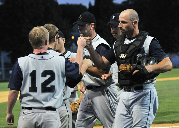 Danvers: Peabody Champions player Ben Hart, left,  knocks fists with catcher Mike Giardi after finishing an inning.   Photo by Mark Teiwes / Salem News