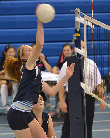 Peabody: Peabody's Carolyn Scacchi spikes the ball for a point against North Andover.  photo by Mark Teiwes / Salem News