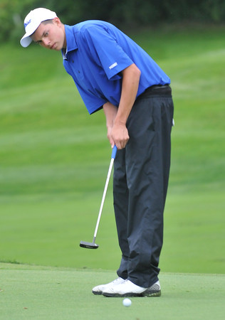 Danvers:  Danvers High School golfer George Merry putts on the 5th hole. photo by Mark Teiwes  / Salem News