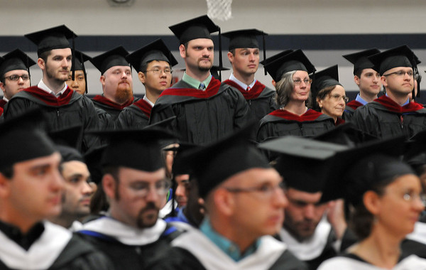 Wenham: Gordon Conwell Masters of Divinity student stand during their graduation ceremony. photo by Mark Teiwes / Salem News
