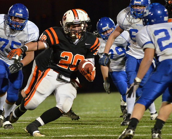 Lynn:  Beverly Fullback Nick Theriault runs for a 27 yard touchdown eluding Scituate's defense. photo by Mark Teiwes / Salem News