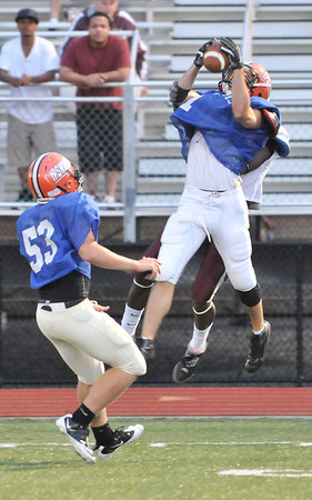 Lynn: Ipswich's John Eldredge, right, makes an interception watched by Nils Swenson (53) also from Ipswich at the 50th annual Agganis All-Star Football Classic .  photo by Mark Teiwes  / Salem News