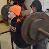 Beverly:   Beverly High School football player Alex Negron does a squat spotted by Kevin Kennedy.  photo by Mark Teiwes / Salem News