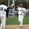 Danvers:  The Danvers High School baseball captain Nick Gikas, right, scores a run welcomed at home by Scott Hovey (18).photo by Mark Teiwes / Salem News