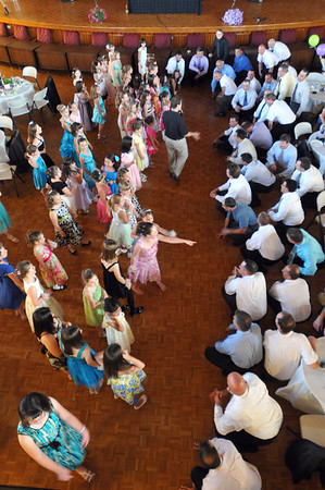 Peabody: All the fathers kneel down before their daughters during a game at the annual father/daughter ball.  photo by Mark Teiwes / Salem News