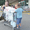 Salem: Freda Menirovsky of Swampscott and her son Lidik Zavrigev, 5, come out of Market Basket in Salem with a cart full of groceries.  She lives on the coast but is not too worried about the coming storm.  photo by Mark Teiwes / Salem News