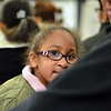 Salem: Kindergartner Maria Lafontant, 5, sits in the meeting with her parents.  photo by Mark Teiwes / Salem News