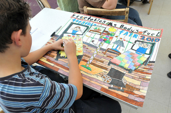 """Salem: Greenhouse school student Max Gieg works on a poster for a Topsfield fair contest themed """"Vegetables, My Body's Food."""" photo by Mark Teiwes / Salem News"""