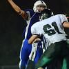 Danvers: Danvers High School quarterback Paul Nicolo launches a pass over the Pendtucket defensive line.  photo by Mark Teiwes / Salem News