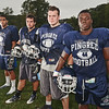 Hamilton: The Pingree football captains are Vini Aguiar, left, Dylan Taylor, Jerry Cronin, and Kenny Adinkra.  photo by Mark Teiwes / Salem News