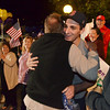 Peabody: P.J. Campbell, lance corporal in the Marines, gets a hug after returning home for the first time after being wounded in Afghanistan. His brother Michael, right, was the first to welcome him home.  photo by Mark Teiwes / Salem News