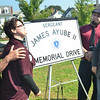Salem: The Ayube family reacts after seeing the new road sign for the first time.  From left, James, Lauren, Alex, Christina, Ashleigh Ayube.    photo by Mark Teiwes / Salem News