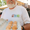 Salem: Peter Maitland, egg farmer and owner of Maitland Mountain Farm in Salem, sells eggs during the Salem Farmers Market at Derby Square.   photo by Mark Teiwes / Salem News