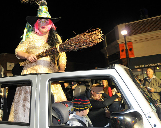 """Salem: Ken """"Blanch"""" Glover of Beverly wields an old broom stick during the parade.  photo by Mark Teiwes / Salem News"""
