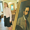 Ipswich: The Ipswich Museum is running an exhibit of art by Ipswich artist Francis Henry Richardson curated by Stephanie Gaskins, a granddaughter of the artist.  She stands beside to his self-portrait.  photo by Mark Teiwes / Salem News