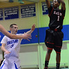 Danvers: Salem's Christian Dunston puts up a jumpshot outside the the reach of Danvers guard Cormick Powers .  photo by Mark Teiwes  / Salem News