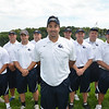 The Swampscott High School football coaching staff is lead by head coach Steve Dembowski, center.  photo by Mark Teiwes /  Salem News