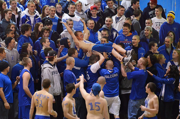 Danvers:  Danvers High School students send a fan up the bleachers crowd surfing as their boys basketball team went on to win the first round of the Division 3 North playoffs, their first playoff win since 2004.  photo by Mark Teiwes / Salem News