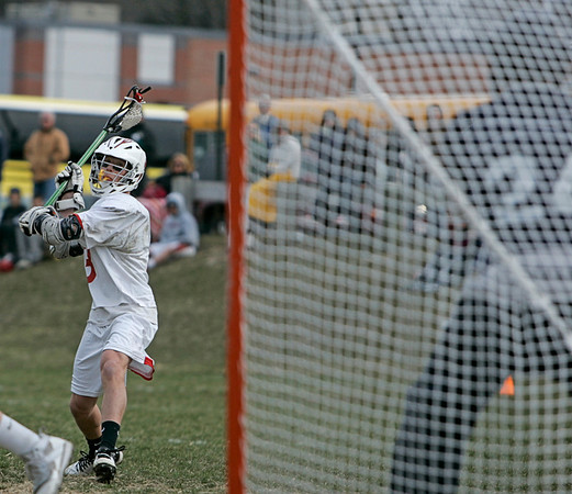 Topsfield: Masco's Wes Shrewbury winds up for a shot scoring a goal on Hamilton-Wenham.   photo by Mark Teiwes / Salem News