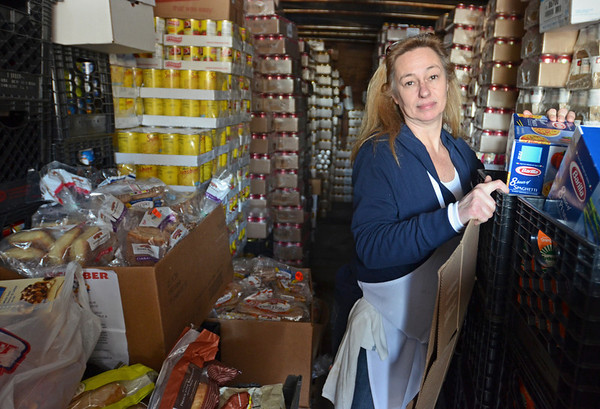 Peabody: Paula Diaz, Haven from Hunger coordinator, stands in a storage room for non-perishable goods. photo by Mark Teiwes  / Salem News