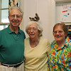 Marblehead: From left, Cy and Marilyn Fishman of Swampscott and Sally Scott of Marblehead came to show their support for the artists at the Three Diverse Women reception.    photo by Mark Teiwes / Salem News