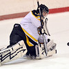 Peabody: Bishop Fenwick goalie Brad Rocheville comes out to make a save.  photo by Mark Teiwes / Salem News