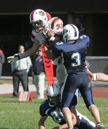 Peabody: Beverly's Brendan Flaherty leaps for a touchdown as Peabody's Casey Grenier (3) tries to stop him.  photo by Mark Teiwes / Salem News