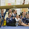 Gloucester: The Peabody High School gymnastics team cheers as a teammate competes on the beam.  photo by Mark Teiwes  / Salem News