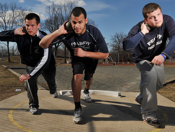 Peabody: The team's shotput and discus throwers are Brandon Quach, left, Joel Medrano, and Cole Behsman.  photo by Mark Teiwes / Salem News