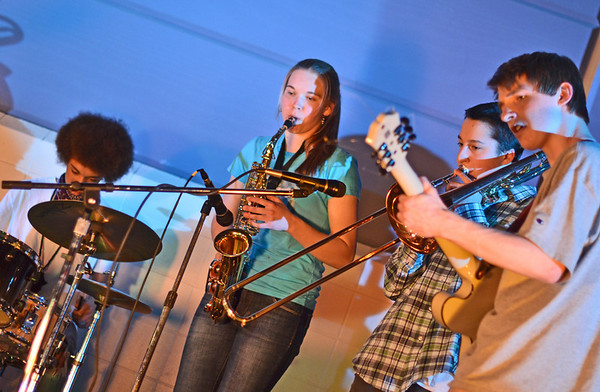 Ipswich: Matthias Marlier, left, Hannah O'Flynn, Connor O'Brien, and Ryder Hambley play in the band Map of the Stars, one of four bands that played for a Ipswich student-organized fundraiser to help the family of Wes Evans, a graduate recovering from a ski accident.   photo by Mark Teiwes / Salem News